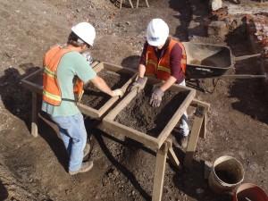 URS archaeologist screening the yard deposits
