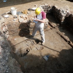 Recording pet burials located in a basement floor